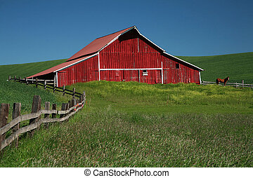 Red barn, fence and brown horse