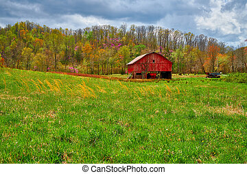 Red Barn in a Hay Field