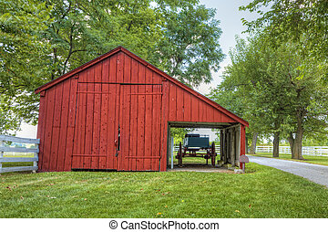 Red barn - Old red barn and a carriage in a historic shaker...
