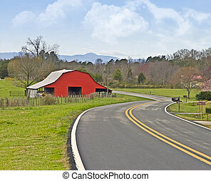 Red Barn on a Curving Road