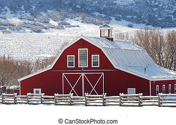 Red barn in the winter with snow.