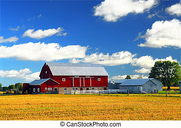Rural landscape with red barn in rural Ontario, Canada.