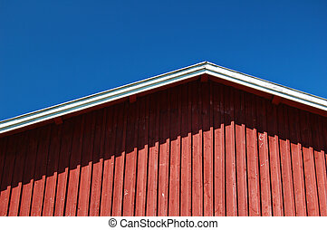 Red barn - Wooden wall and roof of Finnish barn