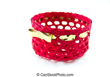 Red basket with golden ribbon