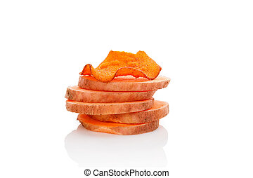 Red batata chips - Fried and raw red batata chips isolated...