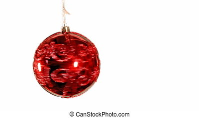 red bauble spinning - red christmas decoration spinning and...