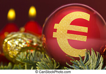 Red bauble with the golden shape of a Euro symbol. (series)