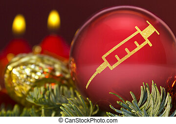 Red bauble with the golden shape of a syringe. (series)
