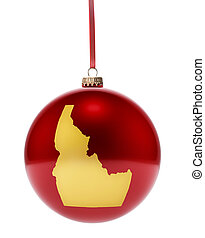 Red bauble with the golden shape of Idaho.(series) - A...