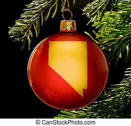 A red bauble with the golden shape of Nevada hanging on a christmas tree isolated on black.(series)