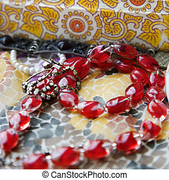 Red bead necklace. - Close up of red bead necklace against...