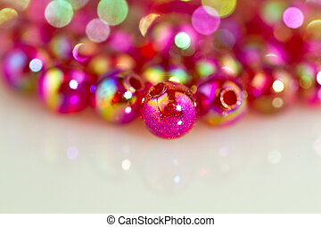 red beads white surface background