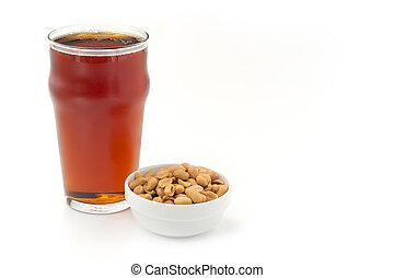 red beer and peanuts on white background
