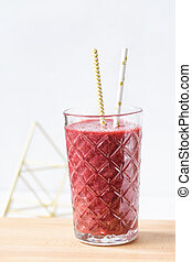 Red beet, blueberry and strawberry smoothie in a glass