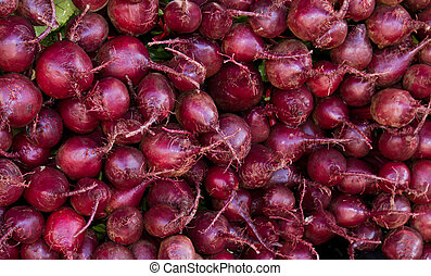 Red beets on display at the farmer's market - Freshly...