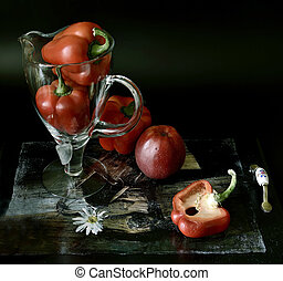 Red bell pepper in a glass vase.