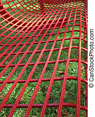 Close up of a red bench after rain