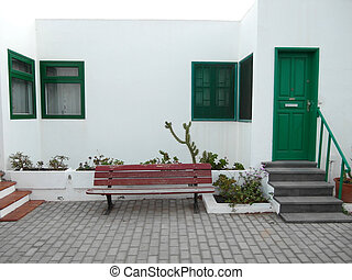 bench in front of the wall