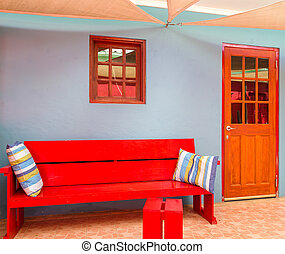 Red Bench on Blue Wall