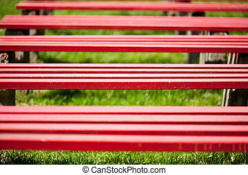 Red benches in a park