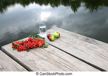 Red berries viburnum on a wooden table