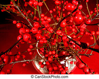 Red berry tree branches in a vase