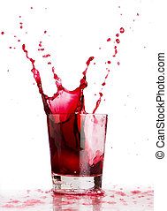 Red beverage splash - Ice cube dropped into a glass of grape...