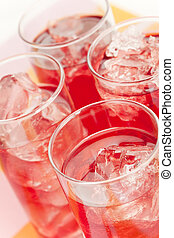 Red beverage - Chilled red beverage with ices on the tall...