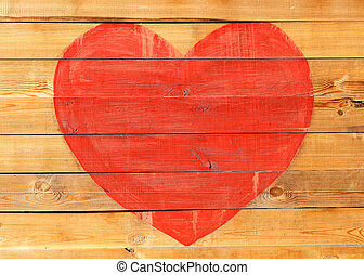 Red big heart on a wooden board