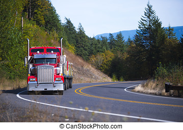 Red big rig Semi Truck with trailer winding road - Muzzle...