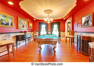 Red billiard luxury room with play pool.