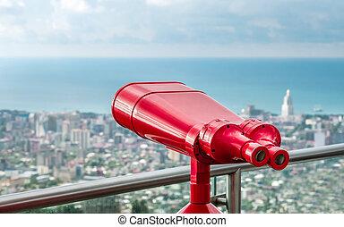 Red binocular tower viewer
