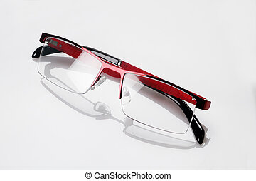 Red Black Eyeglasses with Reflection on White Background