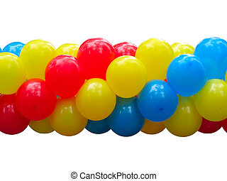 Red, blue and yellow celebration balloons in stack isolated