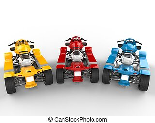 Red, blue and yellow modern quad bikes - top back view