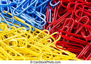 red blue and yellow paper clip background