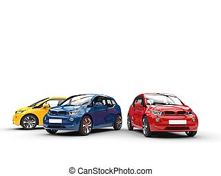 Red, blue and yellow small electric cars
