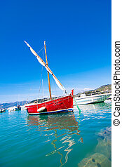 red boat in blue sea