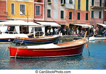 Red boat in the port of Portofino, Italy