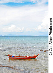 red boat in the sea