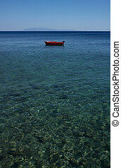red boat moored alone in the sea