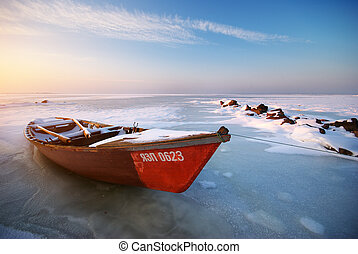Red boat on sunset - Boat on ice. Winter landscape...