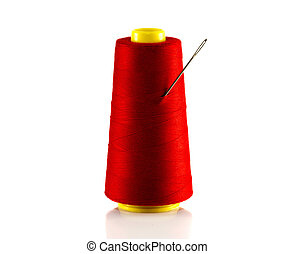 red bobbin with thread and needle