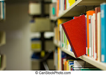 red book popping out a bookshelf