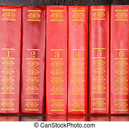 Red books standing in a row