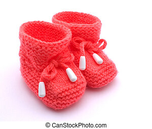 Red booties. - Red baby booties on a white background.