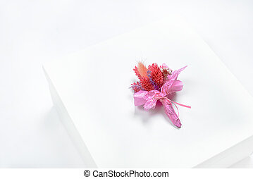 Red bouquet of dried flowers on a white background