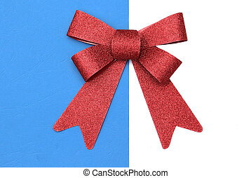 Red bow for presents on white blue background