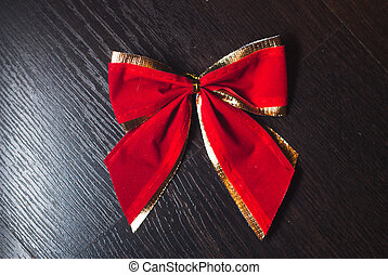 red bow on a black background,