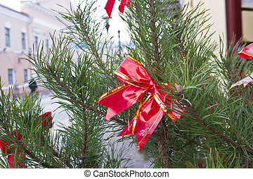Red bow on a Christmas tree